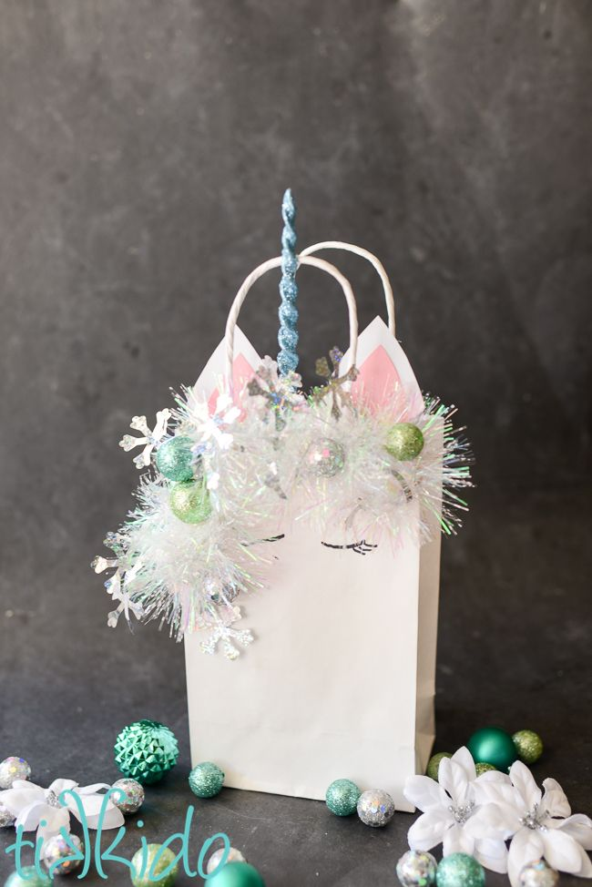 Tutorial for making an easy, wintery, Christmas unicorn gift bag for all your magical gift wrapping needs this holiday season.