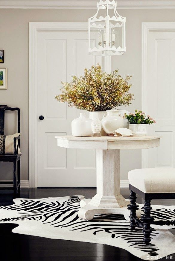 Black and white, zebra rug, white pedestal table, Designer - Betsy Burnham