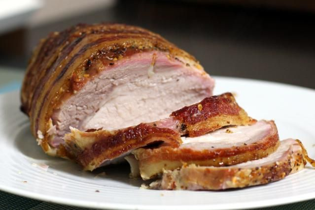 Here's a recipe for an effortless bacon-wrapped glazed roasted pork loin with honey and bourbon in the glaze. It's a moist, tender pork loin roast recipe with boneless pork loin and bourbon, along with bacon and honey.