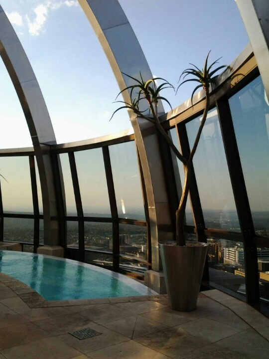 Rim-flow pool with a view, penthouse suite, Michaelangelo Hotel, Sandton.