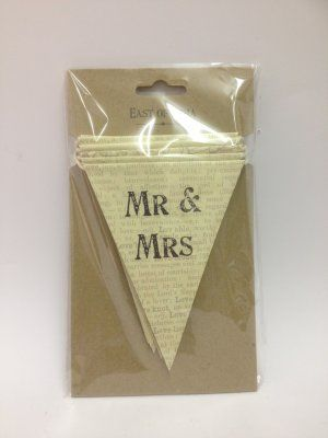 Mr & Mrs Bunting £12.99 East of India 'Mr and Mrs' bunting,cream flags with Mr & Mrs on each one and the dictionary description of love in background, joined by cream string. Ideal to decorate the venue on the special day. Approx Dimensions: H: 12.5cm x W: 300cm x D: 0.1cm
