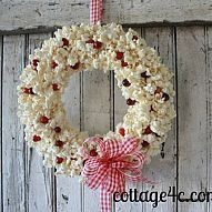 Popcorn and Cranberry Wreath This wreath is so, so simple! If you like the look of popcorn garland on the tree but have dogs that would help themselve...