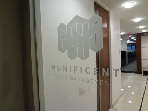 Custom frosted vinyl logo applied reverse from inside facing out onto clear glass office door in