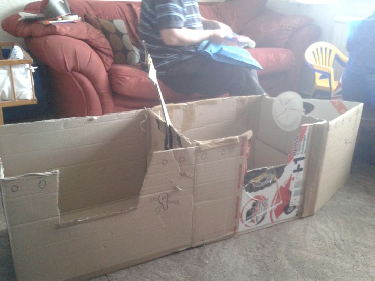 pirate day - boat made from two cardboard boxes. steering wheel is a paper plate and a split pin.