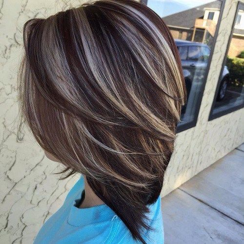 Dark brunette hair with blonde highlights.