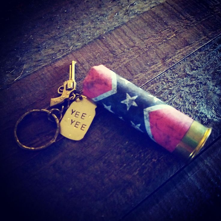 Rebel loud and redneck proud. The fabulous Confederate flag wrapped around a 12 gauge shotgun shell along with a brass mason jar charm.