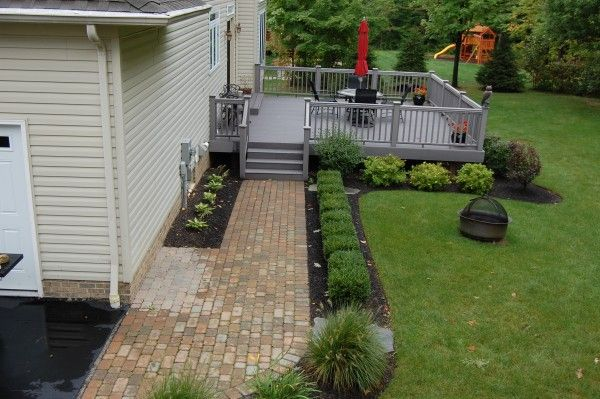 A Custom deck & Tumbled walkway in Chagrin Falls, OH by Hoehnen Landscaping