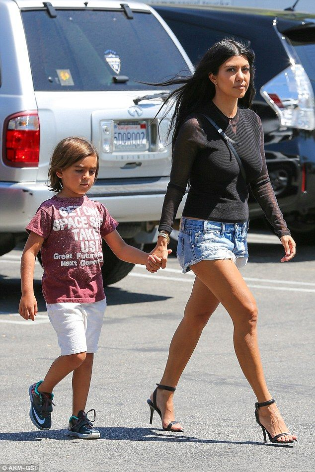 Back to work:Kourtney Kardashian strutted her way to the supermarket in Calabasas, California, on Thursday with son Mason to film Keeping Up With The Kardashians