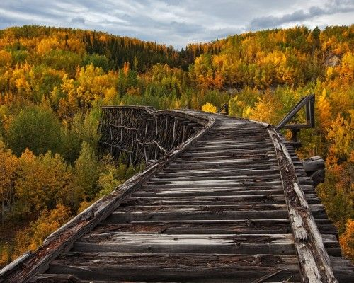 Decayed and abandoned bridge in Alaska, originally built in 1901.