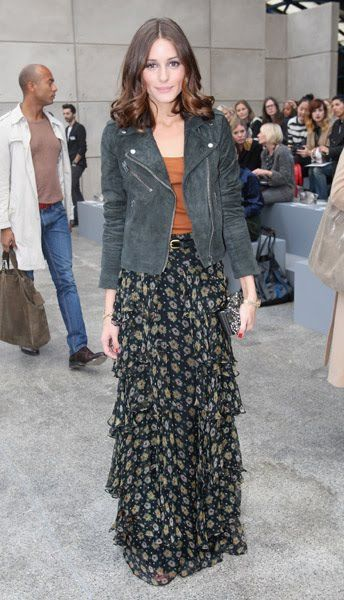 Olivia Palermo combines a layered maxi skirt with a simple tan vest and military-esque jacket.