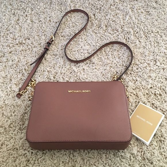 Michael Kors cross body bag. Gorgeous mauve handbag purchased early in the fall. Excellent condition! Very clean interior. Hardware is a beautiful gold. A combination of mauve and brown in color. Michael Kors Bags Crossbody Bags