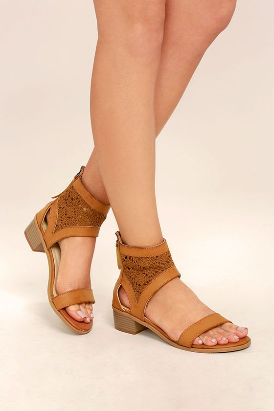 """Create a look worthy of applause with the Kalama Camel Lace Heeled Sandals! These stunning vegan leather sandals have a slender toe strap, and ankle-high quarter strap with crocheted lace, and 4.5"""" heel zipper."""