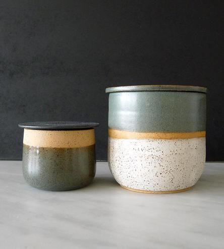 his duo of handmade ceramic jars (with lids!) can be deployed just about anywhere you require a little storage assist. Sugar and salt on the table? Done. Cotton balls and bathroom flotsam? Absolutely.