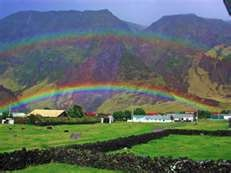 Tristan da Cunha.........Tristan da Cunha ( /ˈtrɪstən də ˈkuːnə/) is part of the British overseas territory of Saint Helena, Ascension and Tristan da Cunha , which also includes Saint Helena 2,430 kilometres (1,510 mi) to its north, and equatorial Ascension Island even farther removed.  Tristan da Cunha is a remote volcanic group of islands in the south Atlantic Ocean and the main island of that group. It is the most remote inhabited archipelago in the world.