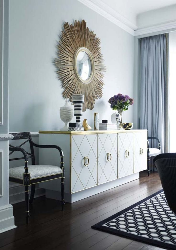 In this beautifully styled living room by Greg Natale, the star is a magnificent white cabinet trimmed in a gold finish. Above it hangs a lovely starburst mirror. The feeling is elegance and glamour. Beautifully composed and lovely to look at.....V