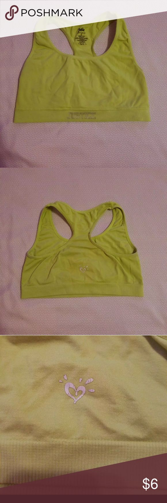 Justice sport bra Justice sport bra size 32. Some fading due to wash/wear. Logo on back has some cracking as seen in 3rd photo Justice Other