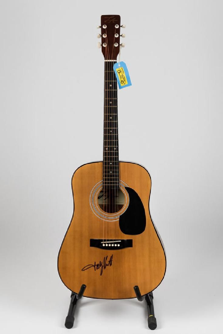 This blonde LA acoustic was boldly signed by popular country singer Toby Keith