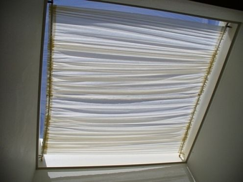 curtain rods on sides, fabric held at top, push fabric up from bottom to open