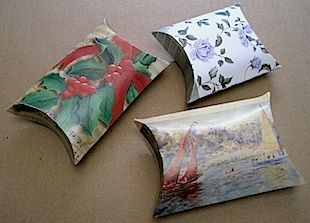 Christmas Card Pillow Boxes -- this site gives detailed instructions on how to make these.