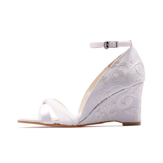 These three inch ivory white wedges are the perfect bridal accessory. They are perfect if you are having a garden or beach wedding. They come