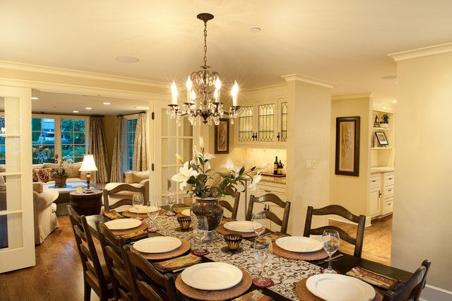 This is such a pretty room - from the wall color, chandelier, to the many place settings.  I love it.