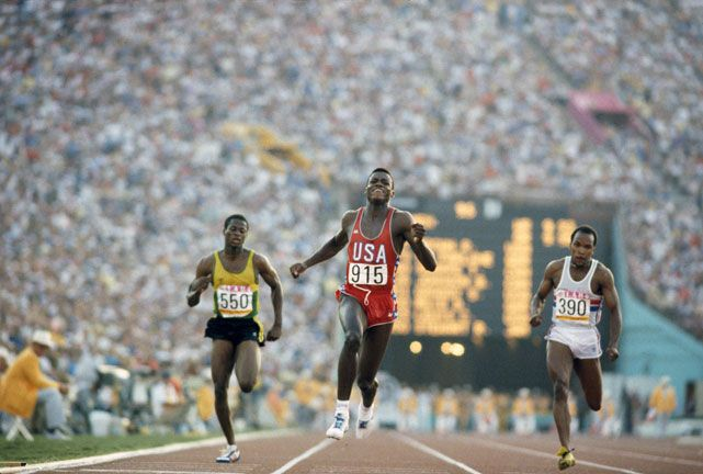 1984 Summer Olympics: USA Carl Lewis runs to victory at the 100 meters during the 1984 Summer Olympics. Lewis won four gold medals — the 100m, 200m, 4x100m relay and long jump - during the Los Angeles games.