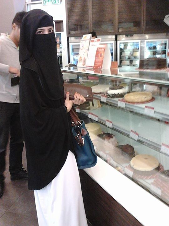 Niqabi enjoying herself