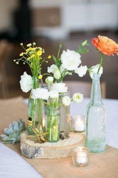 10 Cheap Centerpiece Ideas for Your DIY Wedding -  bottles, flowers  https://www.toovia.com/top/10-cheap-centerpiece-ideas-for-your-diy-wedding