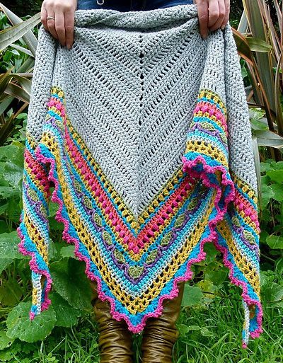 Love the idea of really dressing UP a simple afghan with elaborate bordering!!!  Rainbow crochet shawl