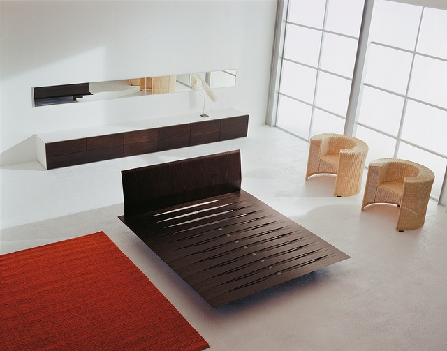 Sottiletto / Design: Burtscher & Bertolini, 1997 / Sottiletto is versatile and suitable for any bedroom. This time, wood takes centre stage, as its expressiveness is highlighted by the flexible slats created out of the same beech plywood flatbed to maximize ergonomics. Ideal mattress ventilation is achieved through the use of spacers, their number depending on the weight to be supported. The bed is completed with solid square feet.