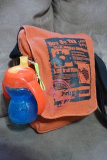 Neat Way to Hang Sippy Cup on Small Diaper Bag or hand bag by just using a pacifier clip!