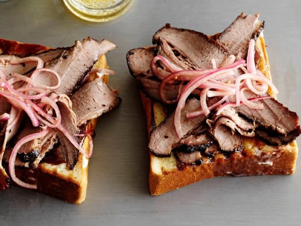 Recipe of the Day: Bobby Flay's Smoked, Spice-Rubbed Brisket It starts with a rub of ten spices that sets in overnight, and it ends with the most tender, flavorful brisket you can make by grilling the meat slowly over indirect heat. Don't trim the fat; It will melt and baste the brisket so it stays incredibly tender and flavorful.