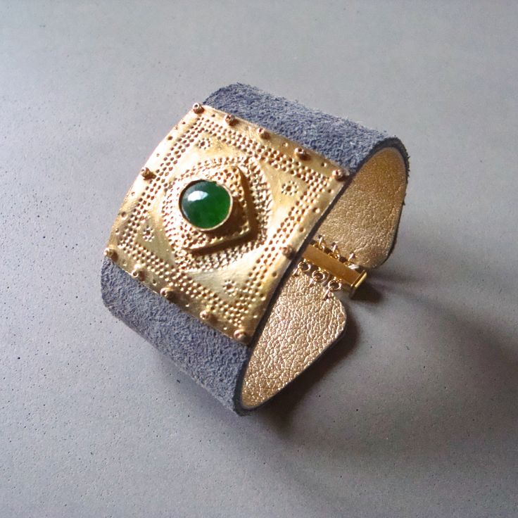 V I R E N T I — Grey suede Vermeil cuff. Soft luxurious Grey suede cuff with gold vermeil and a faceted oval Emerald. Slide lock clasp. 1.5 X 7 inches. — $175.00