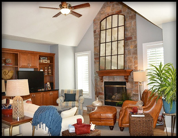 Transitional Living Room With Statement Mirror, Designer: Lorrie  Interioru2026