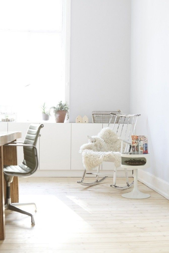 Eames Aluminum Group Management chair in office with pine floors of Wiesbaden Apartment by Studio Oink | Remodelista