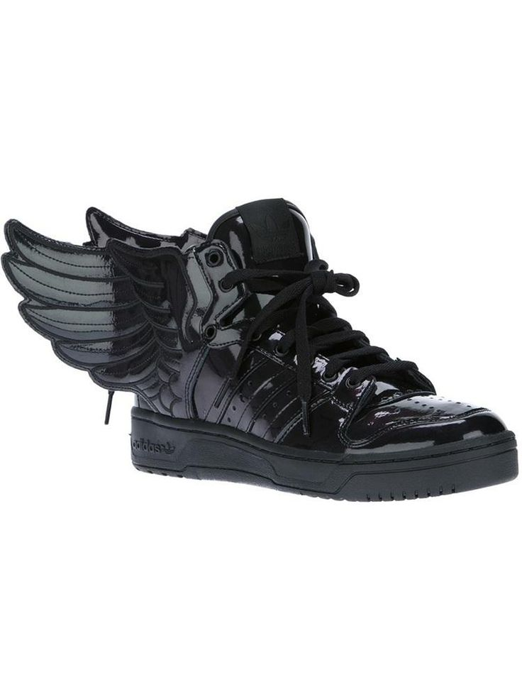 Metal black patent leather hi-top sneaker from Adidas Originals by Jeremy Scott featuring a round perforated toe, a front lace up fastening, signature striped paneling to the sides, winged...