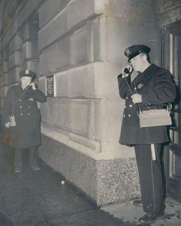 """Chicago police testing their """"walkie-talkies"""", 1952, Chicago."""