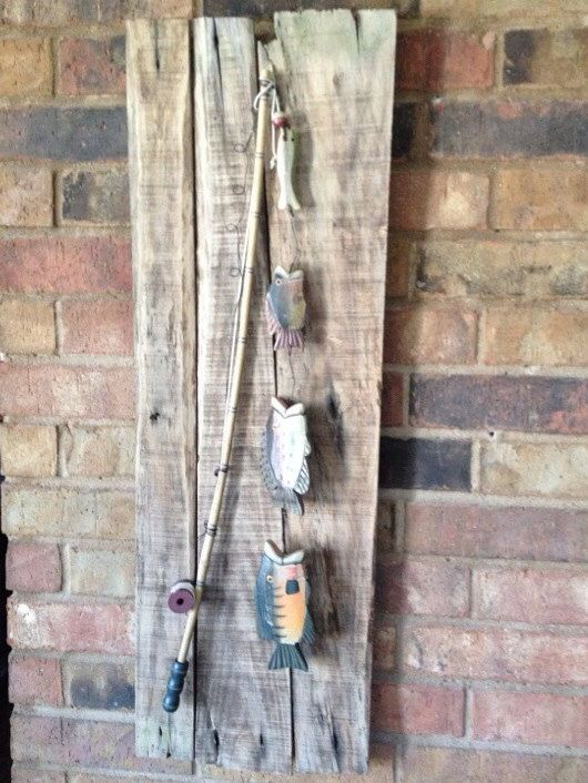 Rustic Wooden Fishing Pole With Wooden Fish On By
