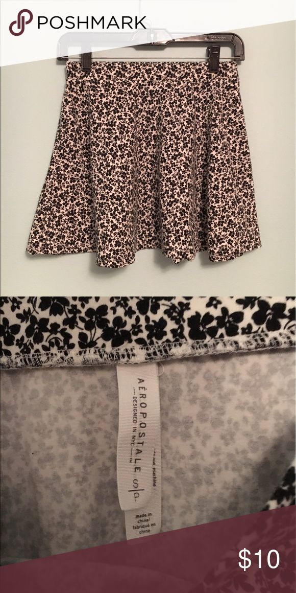 floral circle/skater skirt NWOT, black and white floral print Aeropostale brand circle/skater skirt with thick elastic waist band sized small. No flaws!  #nwot #brandnew #aeropostale #skirt #circleskirt #skaterskirt #floral #blackandwhite #small Aeropostale Skirts Circle & Skater