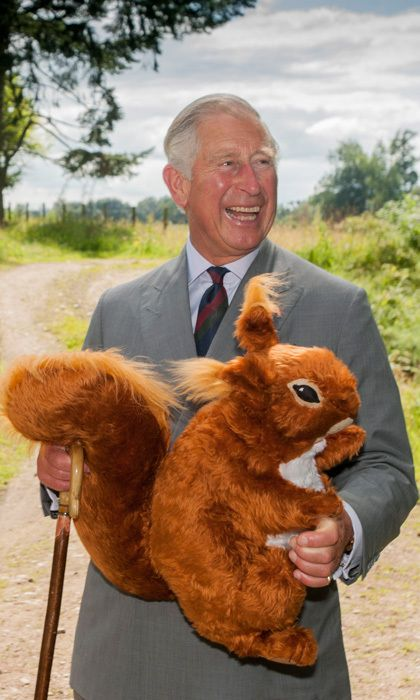 G: GRANDFATHER: Having never known his own grandfathers (Charles was only three when George VI died, and he never met his paternal grandfather, Prince Andrew of Greece and  Denmark), Charles is keen to know William and Kate's children. He was gleeful when presented with this gift of an enormous stuffed squirrel for George last year. Photo: © Paul Watt/PA/Keystone Press