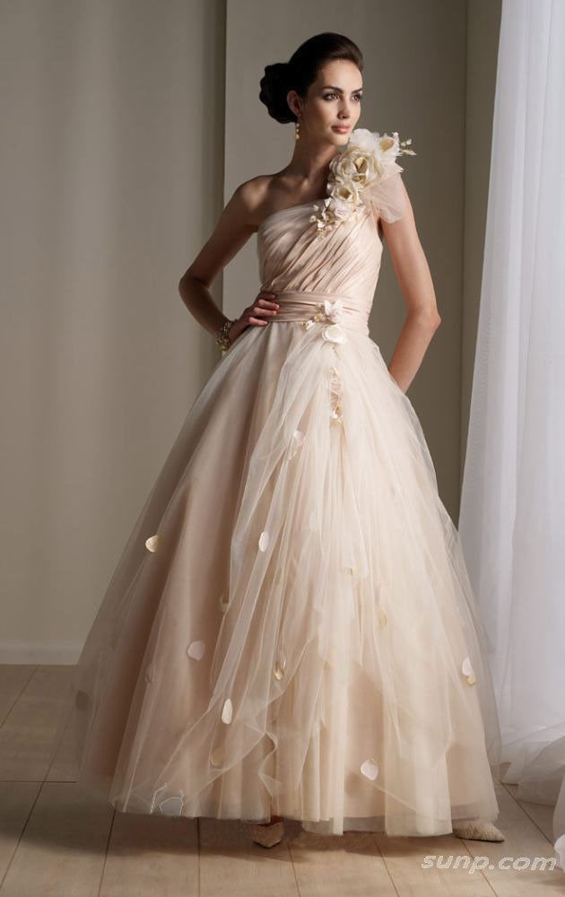This Warm Wedding Dress Hue Is Similar To Beige But Champagne