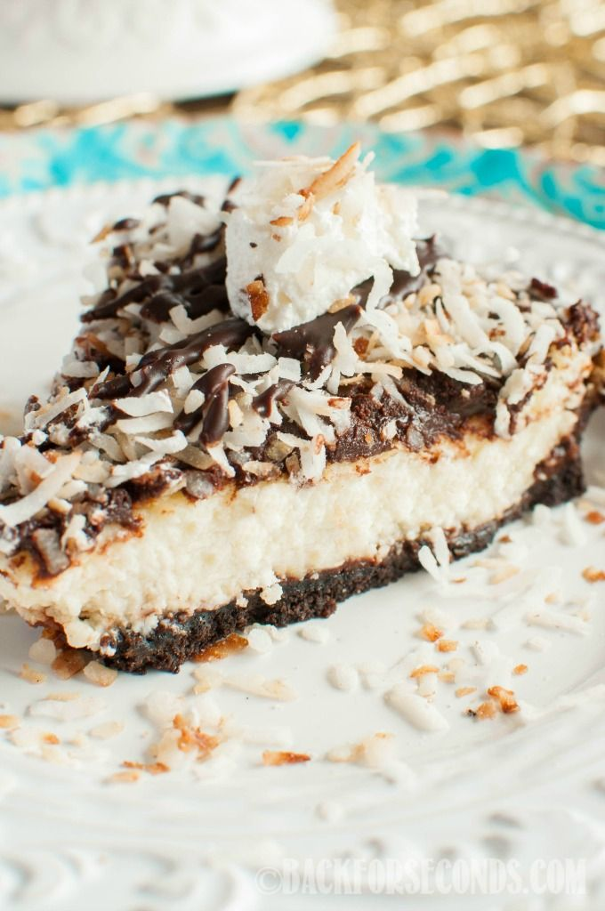 Toasted Coconut Fudge Cheesecake - an Oreo fudge crust layered with creamy coconut cheesecake, topped with chocolate ganache and toasted coconut! Heavenly!