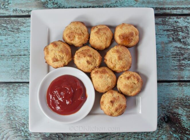 No need to drag out the deep fryer for these tasty nuggets. They are just like regular hush puppies but are baked in muffin tins instead of deep frying.   CDKitchen.com