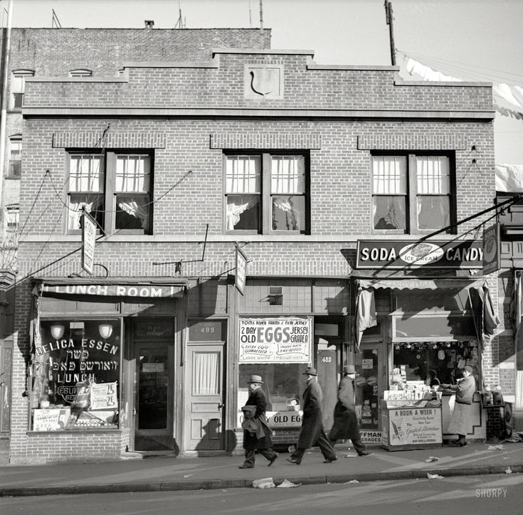 "December 1936. ""Store at which Mrs. Hotchfield does her shopping. Washington Avenue, the Bronx."""