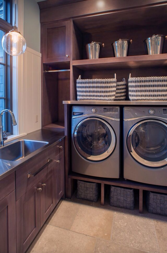 Dark wood ❤️ Shelves/baskets under the washer+dryer - brilliant! Who needs to pay $400 for those pedestals?!