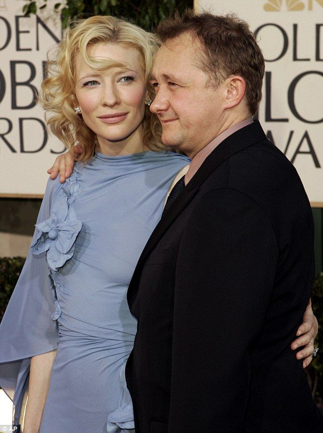 Happy family: Cate shares four children with her respected Australian playwright husband, Andrew Upton, 50