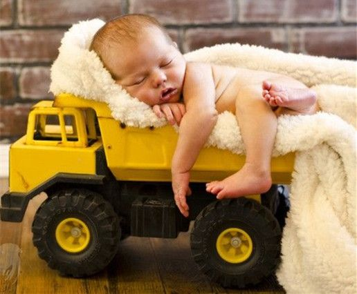 Sleepy cute baby photos in toy truck