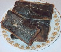 In Puerto Rico, pasteles (pas-TEL-les) are a cherished culinary recipe. The masa consists of a combination of grated green banana, green plantain and taro root. I remember my mom made these for Thanksgiving and Christmas. It brought the family together, especially when the grating needed to be done. She always made over a hundred. Tedious but so much fun. Times gone, but the memories remain.