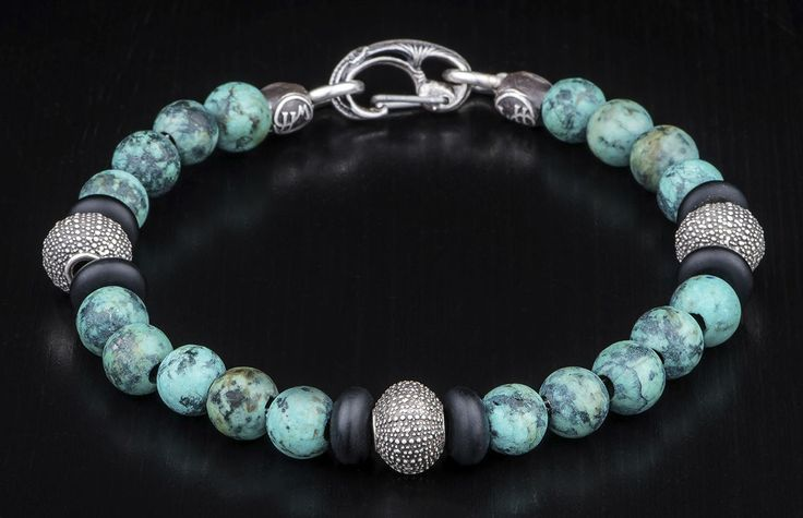 This William Henry Beaded Bracelet features Turquoise, Onyx and Sterling Silver elements.