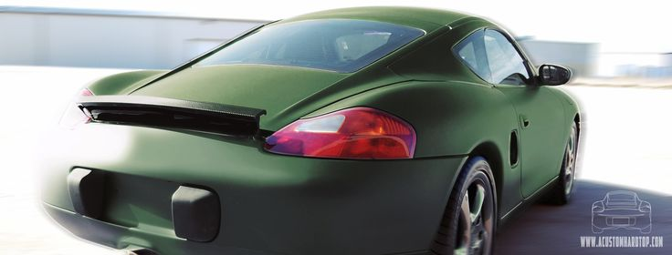 Our social media header, the back of an olive green porsche boxster with an installed hardtop.